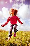 Little girl jumping against a beautiful sky Stock Photo - Royalty-Free, Artist: tan4ikk                       , Code: 400-05668216
