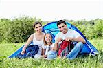 A happy family with a child in a tent Stock Photo - Royalty-Free, Artist: Deklofenak                    , Code: 400-05668714