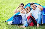 Smiling family with a backpack tent Stock Photo - Royalty-Free, Artist: Deklofenak                    , Code: 400-05668717