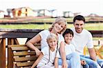 Happy family homes on the background Stock Photo - Royalty-Free, Artist: Deklofenak                    , Code: 400-05668789