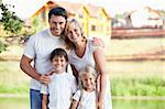 Happy family homes on the background Stock Photo - Royalty-Free, Artist: Deklofenak                    , Code: 400-05668790