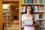 Student holding books in the library Stock Photo - Royalty-Free, Artist: 4774344sean                   , Code: 400-05668882