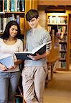 Portrait of students reading a book in a library Stock Photo - Royalty-Free, Artist: 4774344sean                   , Code: 400-05668926