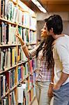 Portrait of students choosing a book in a library Stock Photo - Royalty-Free, Artist: 4774344sean                   , Code: 400-05668935