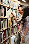 Portrait of young students choosing a book in a library Stock Photo - Royalty-Free, Artist: 4774344sean                   , Code: 400-05668936