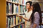 Students choosing a book in a library Stock Photo - Royalty-Free, Artist: 4774344sean                   , Code: 400-05668937