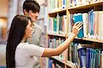Students choosing a book on a shelf in a library Stock Photo - Royalty-Free, Artist: 4774344sean                   , Code: 400-05668952