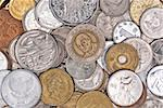 Coins currency from multiple countries, taken from top in isolated background view can be use for financial purposes