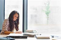 Beautiful student writing an essay in a library Stock Photo - Royalty-Freenull, Code: 400-05669765