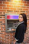 Portrait of a woman withdrawing cash at an ATM Stock Photo - Royalty-Free, Artist: 4774344sean, Code: 400-05670017