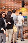 Portrait of an impatient woman queuing at an ATM Stock Photo - Royalty-Free, Artist: 4774344sean, Code: 400-05670022