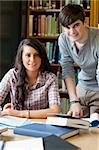 Portrait of smiling students in a library Stock Photo - Royalty-Free, Artist: 4774344sean                   , Code: 400-05670117