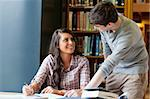 Young students helping each other doing an essay Stock Photo - Royalty-Free, Artist: 4774344sean                   , Code: 400-05670278