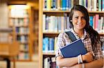 Portrait of a student posing with a book in the library Stock Photo - Royalty-Free, Artist: 4774344sean                   , Code: 400-05670296