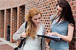 Student showing something to her classmate on a notepad Stock Photo - Royalty-Free, Artist: 4774344sean                   , Code: 400-05670690