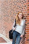 Portrait of a cute student standing up outside a buiding Stock Photo - Royalty-Free, Artist: 4774344sean                   , Code: 400-05670705