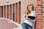 Young student reading her notes outside a building Stock Photo - Royalty-Free, Artist: 4774344sean                   , Code: 400-05670710