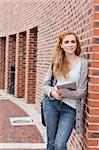 Portrait of a student with a tablet computer standing outside a building Stock Photo - Royalty-Free, Artist: 4774344sean                   , Code: 400-05670713