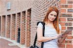 Serious student holding a tablet computer outside a building Stock Photo - Royalty-Free, Artist: 4774344sean                   , Code: 400-05670718