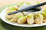 Closeup on plate of steamed dumplings with soy sauce and chopsticks Stock Photo - Royalty-Free, Artist: Elenathewise                  , Code: 400-05671207
