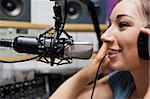 Close up of a young radio host speaking through a microphone Stock Photo - Royalty-Free, Artist: 4774344sean                   , Code: 400-05672201