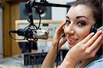 Close up of a young radio host posing in a station Stock Photo - Royalty-Free, Artist: 4774344sean                   , Code: 400-05672202