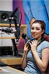 Portrait of a radio host posing during a break Stock Photo - Royalty-Free, Artist: 4774344sean                   , Code: 400-05672205