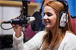 Happy radio host speaking through a microphone Stock Photo - Royalty-Free, Artist: 4774344sean                   , Code: 400-05672208