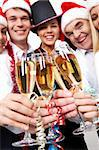 Image of crystal glasses full of champagne held by happy business people Stock Photo - Royalty-Free, Artist: pressmaster                   , Code: 400-05672531