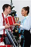 Image of happy businesswoman making present to ceo at corporate party Stock Photo - Royalty-Free, Artist: pressmaster                   , Code: 400-05672544