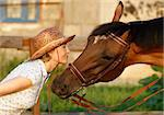 Woman in hat and horse face to face. Close-up portrate Stock Photo - Royalty-Free, Artist: pavelshlykov                  , Code: 400-05673594
