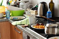 Pile of dirty dishes in the kitchen - Compulsive Hoarding Syndrom Stock Photo - Royalty-Freenull, Code: 400-05674560