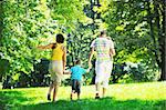 happy young couple with their children have fun at beautiful park outdoor in nature Stock Photo - Royalty-Free, Artist: dotshock                      , Code: 400-05676391