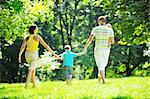 happy young couple with their children have fun at beautiful park outdoor in nature Stock Photo - Royalty-Free, Artist: dotshock                      , Code: 400-05676694