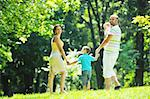 happy young couple with their children have fun at beautiful park outdoor in nature Stock Photo - Royalty-Free, Artist: dotshock                      , Code: 400-05676695