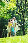 happy young couple with their children have fun at beautiful park outdoor in nature Stock Photo - Royalty-Free, Artist: dotshock                      , Code: 400-05676696