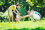 happy young couple with their children have fun at beautiful park outdoor in nature Stock Photo - Royalty-Free, Artist: dotshock                      , Code: 400-05676705