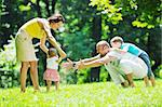 happy young couple with their children have fun at beautiful park outdoor in nature Stock Photo - Royalty-Free, Artist: dotshock                      , Code: 400-05676707