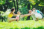 happy young couple with their children have fun at beautiful park outdoor in nature Stock Photo - Royalty-Free, Artist: dotshock                      , Code: 400-05676708