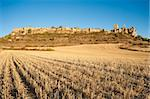 The fortified town of Calatanazor, amidst harvested autumn fields Stock Photo - Royalty-Free, Artist: hemeroskopion                 , Code: 400-05676885