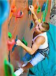 men climbing on a wall in an outdoor climbing center Stock Photo - Royalty-Free, Artist: tan4ikk                       , Code: 400-05677315