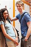Portrait of a happy couple flirting in a corridor Stock Photo - Royalty-Free, Artist: 4774344sean                   , Code: 400-05677849