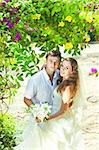 Bride and groom in a tropical garden Stock Photo - Royalty-Free, Artist: GoodOlga                      , Code: 400-05677896