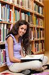 Portrait of a female student with a book in a library Stock Photo - Royalty-Free, Artist: 4774344sean                   , Code: 400-05678032
