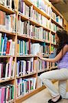 Portrait of a female student choosing a book in a library Stock Photo - Royalty-Free, Artist: 4774344sean                   , Code: 400-05678092