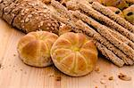 Variety of Organic Breads on plank background ,golden lights were used Stock Photo - Royalty-Free, Artist: yuliang11                     , Code: 400-05679219
