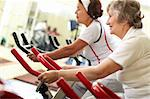 Two senior women exercising on training machines Stock Photo - Royalty-Free, Artist: pressmaster                   , Code: 400-05680479