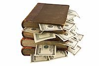 education loan - Money in old books, isolated on white background, business training. Stock Photo - Royalty-Freenull, Code: 400-05680648