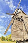 Old wooden windmill against the blue sky with clouds Stock Photo - Royalty-Free, Artist: grauvision                    , Code: 400-05682282