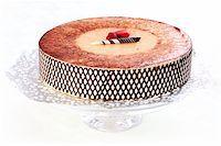 Delicious Tiramisu birthday cake with cherries Stock Photo - Royalty-Freenull, Code: 400-05682520